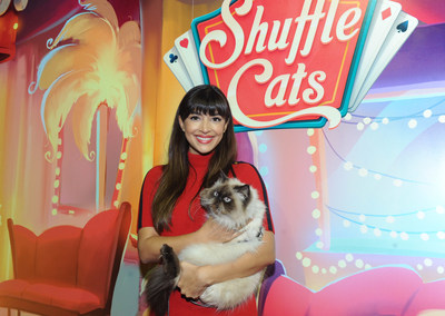 Actress Hannah Simone poses with Wylie Coyote Super Genius, the winner of America's Next Shuffle Cat contest, after a live cat-walk in New York, Tuesday, Dec. 6, 2016.  Wylie will be featured in Shuffle Cats, the new mobile game from King.  (Photo by Diane Bondareff/Invision for King/ AP Images)