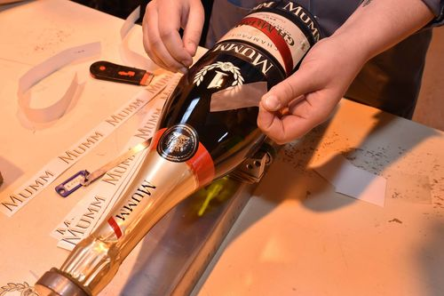 Before beginning its journey to the celebratory podium in Monte Carlo, the final preparations are made to the iconic Jeroboam of Cordon Rouge that will be awarded to the winner of the 2015 Monaco Grand Prix. (PRNewsFoto/Maison Mumm)