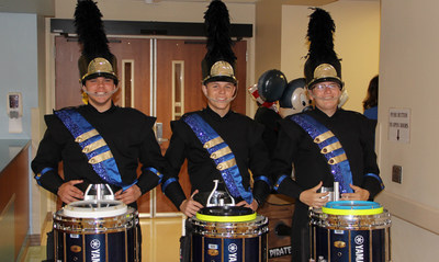 Seniors and snare drummers Matt Mohr, J.D. Dickson and Patrick Sanchez of the Cypress Ranch High School Marching Band led the parade