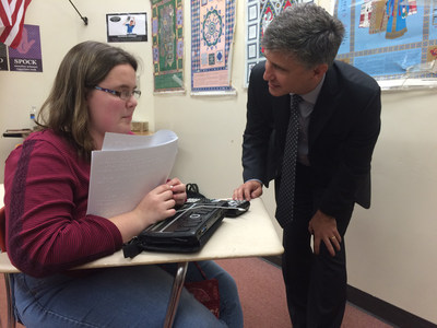 Peter Balyta, Ph.D., president of TI Education Technology, observes Lillie Pennington, 17, using the world's first talking graphing calculator, an innovation of Texas Instruments, Orbit Research and the American Printing House for the Blind.