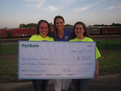 PetSafe presents a $100,000 grand prize check to the city of Texarkana, Ark., the 'top dog' in the 2012 'Bark for Your Park' contest. The prize money will be used to build the PetSafe Jef-FUR-son Dog Park, a local off-leash dog park in Texarkana. Robin Rhea (center) of PetSafe presents the check to Deanna O'Malley (left) and Crystal Sloan (right) of the Texarkana dog park committee.  (PRNewsFoto/PetSafe)