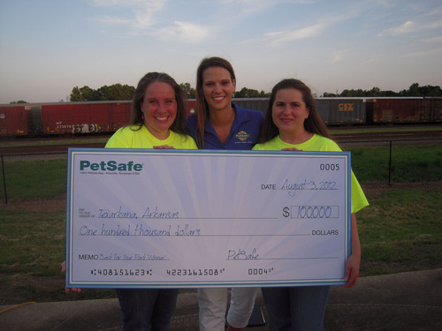 PetSafe presents a $100,000 grand prize check to the city of Texarkana, Ark., the 'top dog' in the 2012  ...