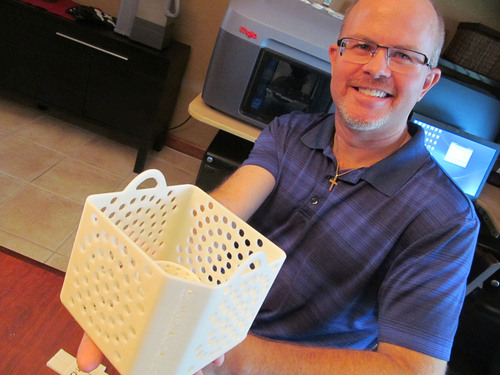Joe Lutgen, winner of the DE-Stratasys Rapid Ready Sweepstakes, shows off a part he printed using the Mojo ...