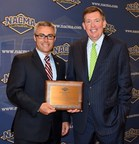 Ben C. Sutton. Jr. recieves award from Eric Nichols - President of NACMA