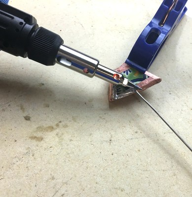 Crafty Chica uses a Bernzomatic ST2200 3-in-1 Micro Torch to turn broken tiles into rings. (Crafty Chica)