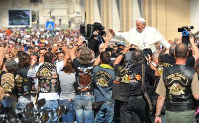 Pope Francis blesses Harley-Davidson motorcycles and riders in Vatican City.