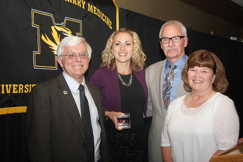 National winner and University of Missouri College of Veterinary Medicine senior, Katherine Nadolny, receives the second annual Bayer Excellence in Communication Award (BECA).  Left to right: Dr. Neil C. Olson, Dean, College of Veterinary Medicine; Katherine Nadolny, BECA National Winner; Dr. Ronald Cott, Associate Dean for Student & Alumni Affairs; Dr. Adrienne Willette, Veterinary Technical Services, Bayer (PRNewsFoto/Bayer HealthCare Animal Health)