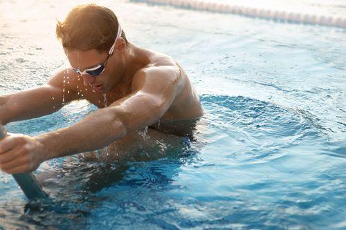 Swimmer wears Speedo Aquapulse Max goggles.