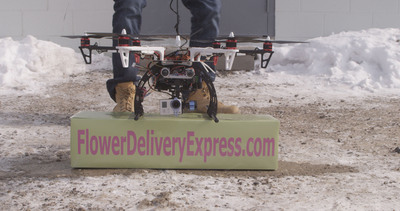 According to Wesley Berry CEO of FlowerDeliveryExpress.com, the first flower delivery by drone  occurred in Metro Detroit on Saturday, February 8th, 2014. The company is recruiting for their consumer focus groups to beta test drone delivery services. Participants will receive products for free and, at, or below cost products in exchange for providing valuable feedback that will help drive future floral products and services. To enlist, visit FlowerDeliveryExpress.com/beta.  (PRNewsFoto/FlowerDeliveryExpress.com)