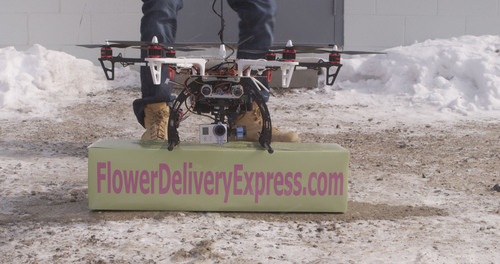 According to Wesley Berry CEO of FlowerDeliveryExpress.com, the first flower delivery by drone occurred in Metro Detroit on Saturday, February 8th, 2014. The company is recruiting for their consumer focus groups to beta test drone delivery services. Participants will receive products for free and, at, or below cost products in exchange for providing valuable feedback that will help drive future floral products and services. To enlist, visit FlowerDeliveryExpress.com/beta. (PRNewsFoto/FlowerDeliveryExpress.com) (PRNewsFoto/FLOWERDELIVERYEXPRESS.COM)