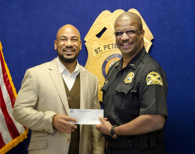 Dr. Christopher Warren, director of the Write Field program at the Poynter Institute, and Tony Holloway, chief of police, St. Petersburg, Fla. (Taken Jan. 4, 2016)