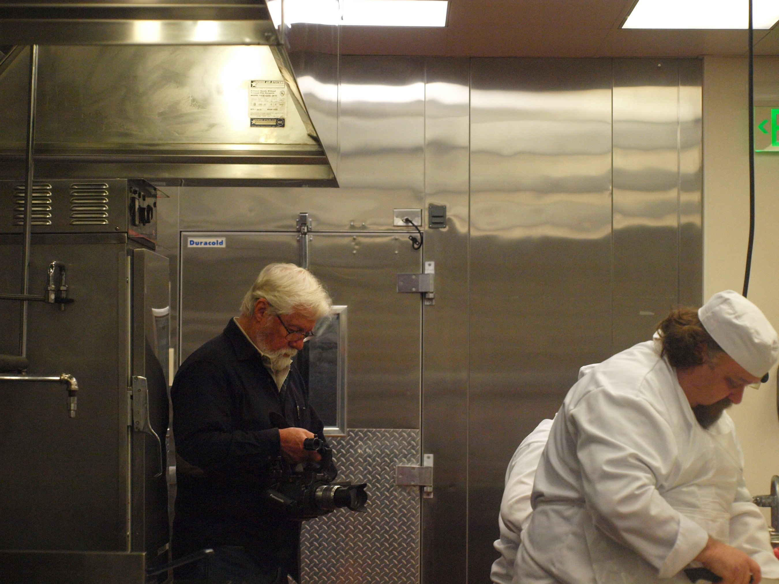 Oscar-winning Director John Korty, homeless adults learning job skills at Homeward Bound's Fresh Starts Culinary Academy