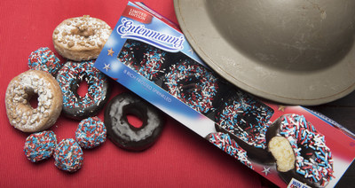 Entenmann's and The Salvation Army get ready to celebrate National Donut Day on June 5 with the new Rich Frosted Patriotic Donuts.  Pictured alongside these delectable treats is a historic metal helmet from WWI that The Salvation Army's 'donut lassies' used to fry donuts for the soldiers to lift their spirits.