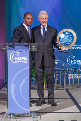 Operation HOPE Founder John Hope Bryant presents award to President Bill Clinton at the 2015 HOPE Global Forum, in Atlanta on January 17