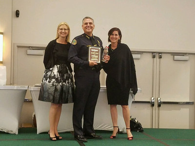 Chief of Police Rodolfo Llanes proudly receives Verizon Wireless' HopeLine Hero Award for his dedication and efforts around domestic violence awareness and prevention. Do The Right Thing, a non-profit organization that recognizes and rewards Miami youths for their exemplary behavior and good deeds, accepted a $10,000 HopeLine grant given to the organization in his honor.