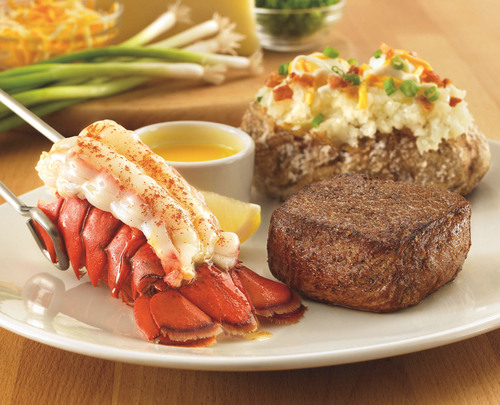 OUTBACK STEAKHOUSE(R) SATISFIES APPETITES AND WALLETS Back by popular demand: Outback's signature sirloin and lobster tail combination starting at $14.99*. (PRNewsFoto/Outback Steakhouse) (PRNewsFoto/OUTBACK STEAKHOUSE)