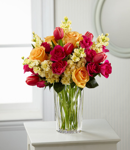 FTD's floral design expert forecasts bright oranges and pinks will be popular this Mother's Day. The FTD Beauty and Grace Bouquet by Vera Wang showcases this trend and will bring a pop of color to the holiday.  (PRNewsFoto/FTD Companies, Inc.)