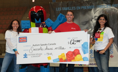 Executive Director of Autism Speaks Canada, Jill Farber, (left) accepts a donation from Robert Goodwin, Executive Director of the Mattel Children's Foundation, and Bisma Ansari, Vice President of Marketing at MEGA Brands Inc., at the Montreal Walk Now for Autism Speaks Canada fundraising event on May 25, 2014. (PRNewsFoto/MEGA Brands Inc.)
