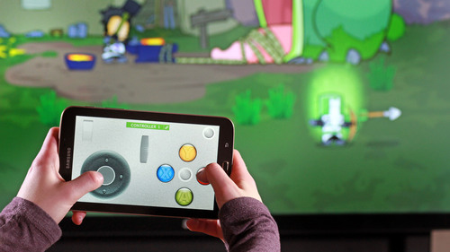 GestureWorks Gameplay Version 2, shown here with Castle Crashers, allows up to four players to interact using Android phones or tablets.  (PRNewsFoto/Ideum)