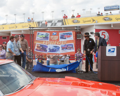 From Left: Daytona International Speedway President Joie Chitwood III;  Muscle Cars Stamp Artist Tom Fritz;  NASCAR icons Kyle and Richard Petty; and, Postmaster General Patrick Donahoe unveil the Limited Edition America on the Move: Muscle Cars Forever stamps at the Daytona International Speedway today.  All 60 million Forever stamps are ready to roar out of the nation's Post Offices today.  (PRNewsFoto/U.S. Postal Service, Daniel Afzal, U.S. Postal Service)