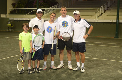 Visiting Members of the Israel Children's Center tennis team pose with BallenIsles junior players and professionals on the Stadium Court at BallenIsles state-of-the-art Sports Complex. Pictured Left to Right: BallenIsles junior players Christopher Mendivil with partner Maks Silag, BallenIsles professional Jay Berman, ICC team player Yossi Dahan, ICC team Coach Yaniv Sakira and BallenIsles professional Ricardo Mendivil.  (PRNewsFoto/BallenIsles Country Club)