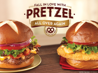 Pretzel fans can reunite with Wendy's Pretzel Bacon Cheeseburger and Pretzel Pub Chicken sandwiches by the weekend of July 4. Available all summer long, the sandwiches feature an artisan-style pretzel bun with a rich flavor and chewy crust. (PRNewsFoto/The Wendy's Company)