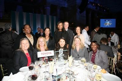 "Toyota associates from all affiliates came together at DiversityInc.'s Top 50 Companies for Diversity(R) awards ceremony to celebrate Toyota's achievement. (left to right) Standing: Dana Green, TMA; Jennifer ""Jae"" Requiro, TFS; Latondra Newton, TMA; Stephen Lewis, TFS; Ann Bybee, TFS. Seated: Midge Waters, TMS; Laura Hochuli, TMA; Yuko Ishikawa, TMA; Shannon Scheuerle, TEMA; Adrienne Trimble, TEMA. (PRNewsFoto/Toyota)"