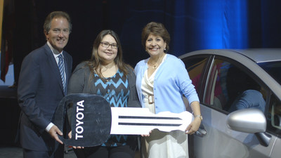 2014 National Council of La Raza Conference: Toyota Division Group Vice President and General Manager Bill Fay (left to right) poses with Audrey Moscosa-Rodriguez, winner of a new Prius, and NCLR President Janet Murguia at the 2014 National Council of La Raza conference, Sunday, July 20, 2014. (PRNewsFoto/Toyota)
