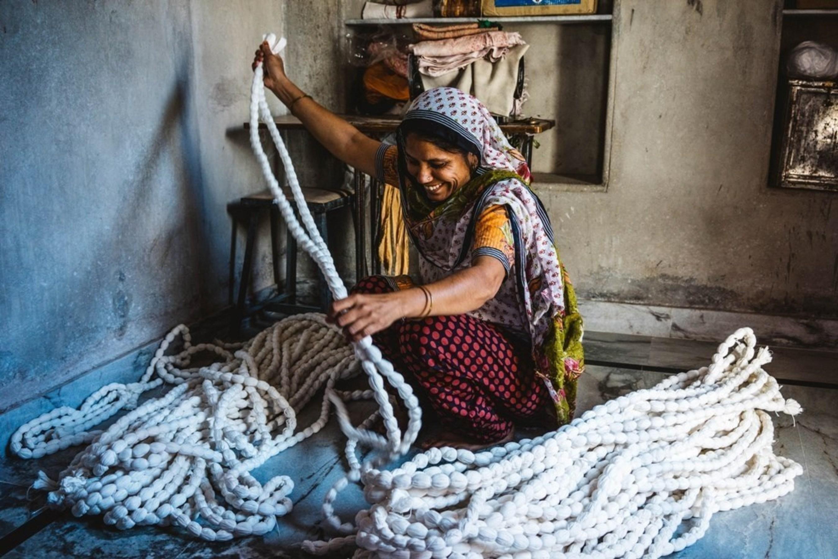 A woman tie-dies fabric in Jodhpur, India.