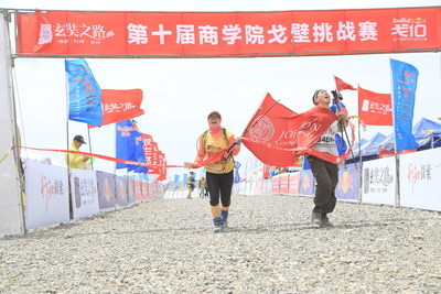 Johnson's Sun and Wang cross the finish line with pride.