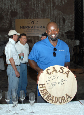NFL Hall of Fame inductee Emmitt Smith kicks off Tequila Herradura's Buy-the-Barrel program with the purchase of his own Herradura Double Barrel Reposado tequila at the brand's Hacienda San Jose del Refugio near Guadalajara, Mexico, on Thursday.  (PRNewsFoto/Tequila Herradura)