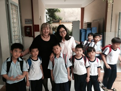 Norma Levkowitz, Solutions Specialist at Time To Know, on a delegation visit to an IAE affiliated school in Vietnam, meeting with a teacher and her students. Time To Know Ed-Tech solutions will soon be implemented across Vietnam.