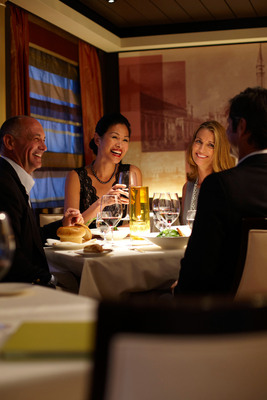 Guests share dinner in Prego, Piero Selvaggio's specialty restaurant aboard Crystal ships.  (PRNewsFoto/Crystal Cruises)