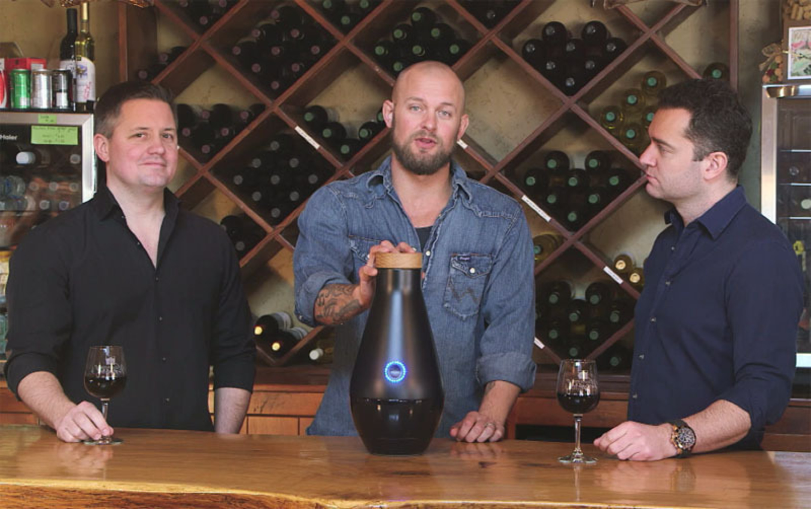 Wine industry experts, Kevin Boyer, President and CEO of CustomVine.com and Philip James, Chairman of CustomVine.com, joined forces with Doc Hendley and www.winetowater.org for The Miracle Machine project to inspire people into action, because there is no life without water. (PRNewsFoto/Wine to Water) (PRNewsFoto/WINE TO WATER)