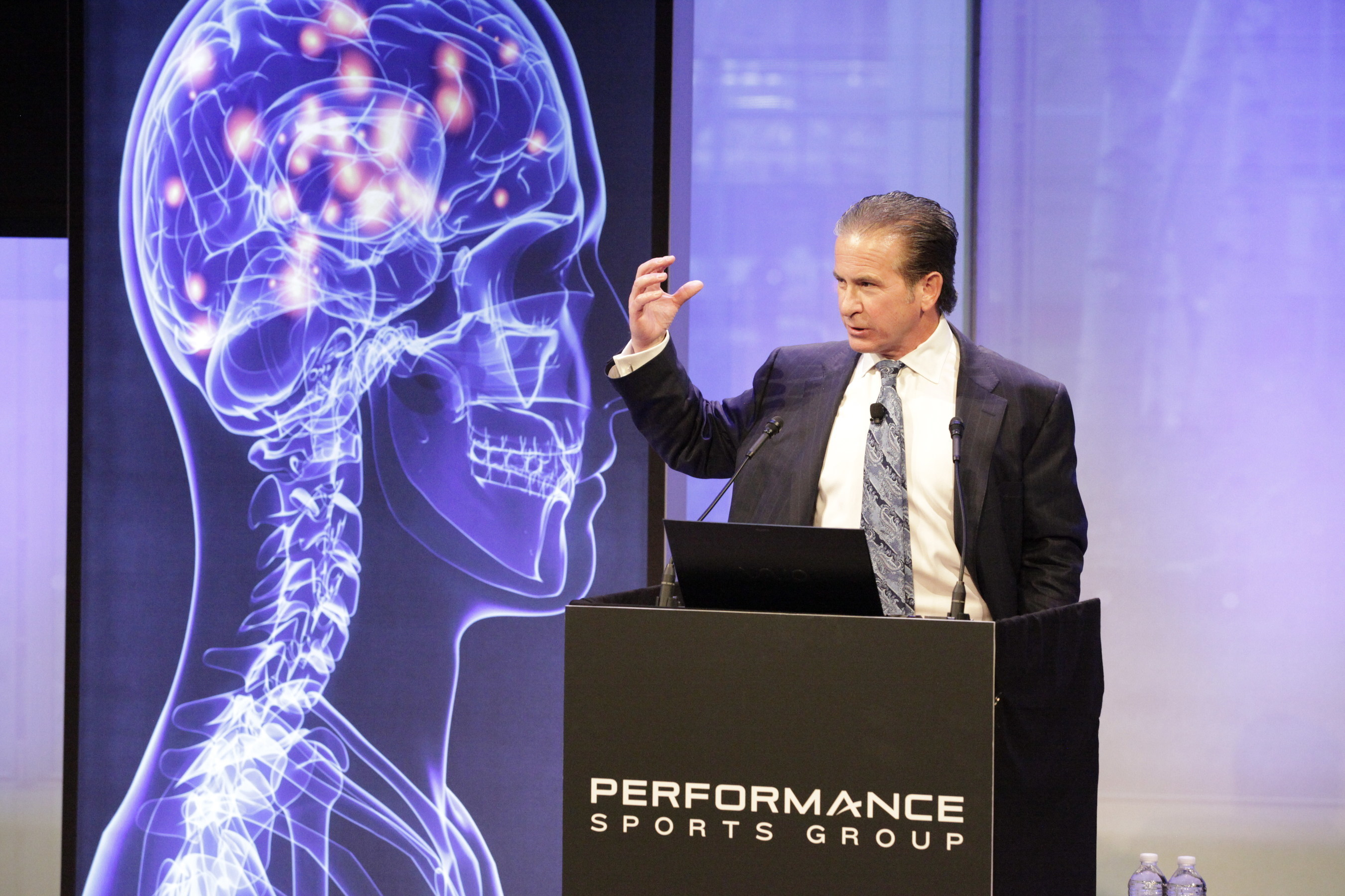 At a Performance Sports Group event earlier today in New York, leading neurosurgeon Dr. Julian Bales unveiled a new device designed to reduce mild traumatic brain injury (mTBI) in sports. The proprietary band, worn on the neck, is the first device of its kind to reduce the risk of mTBI internally by using the body's own physiology rather than external protective devices.