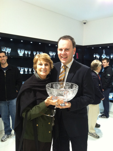 CIE Tours International vacationer Rosemarie Leone was the 250,000th visitor to the famed House of Waterford Crystal. She was presented with a commemorative bowl by Waterford's Commercial Director David McCoy.  (PRNewsFoto/CIE Tours International)