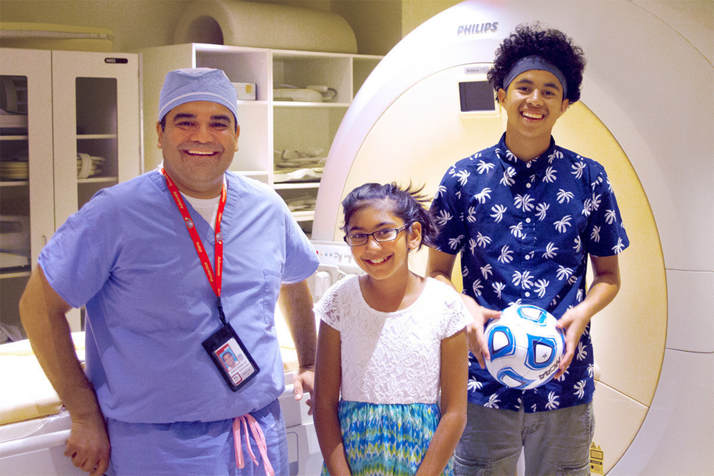 Karun Sharma, MD, PhD, interventional radiologist at Children's National Health System, poses with 10-year-old Niyati Shah and 16-year-old Alfredo Coreas, the first two children with osteoid osteoma successfully treated in the U.S. as part of an innovative research study using noninvasive MR-HIFU.