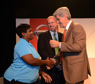 Mississippi Gov. Phil Bryant (right) congratulates Stephanie Sutton (left), a technician at Nissan's Canton Assembly Plant, and Nissan Americas Vice Chairman Bill Krueger (center), at an event announcing production of the all-new 2013 Sentra and the addition of 1,000 new jobs at the plant.  (PRNewsFoto/Nissan North America)