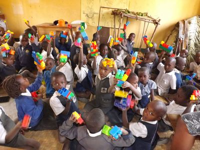 Children play with donated toys at Uganda Lodge. Volunteers can spend time at our own Ruhanga Development School helping to advance its facilities and/or working directly with local children in other capacities. (PRNewsFoto/Uganda Lodge Community Projects)
