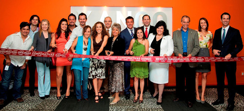 XANGO Founder/Chairman Aaron Garrity (center) joins fellow Founder/Board Member Joe Morton (right)  and Senior VP, North America Scott Smith in a ceremonial ribbon cutting of new company offices May 16, 2011 in Mexico City. Hundreds of the company's distributors also participated in the ceremonies. The new office will facilitate continued company expansion in Mexico.  (PRNewsFoto/XANGO, LLC, Manuel Escareno)