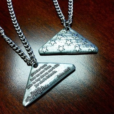 Point 27 gives these Folded Flag Necklaces to Gold Star Children at the Snowball Express