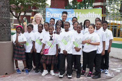 Dominique Dawes, Olympic Gold Medalist and GoGo squeeZ Goodness Ambassador, is all smiles with students at P.S. 6 in Brooklyn, NY after leading a workout and announcing a grant to improve access to healthy foods and fitness on behalf of GoGo squeeZ and Action for Healthy Kids on September 21, 2016. (Photo by Phillip Reed).