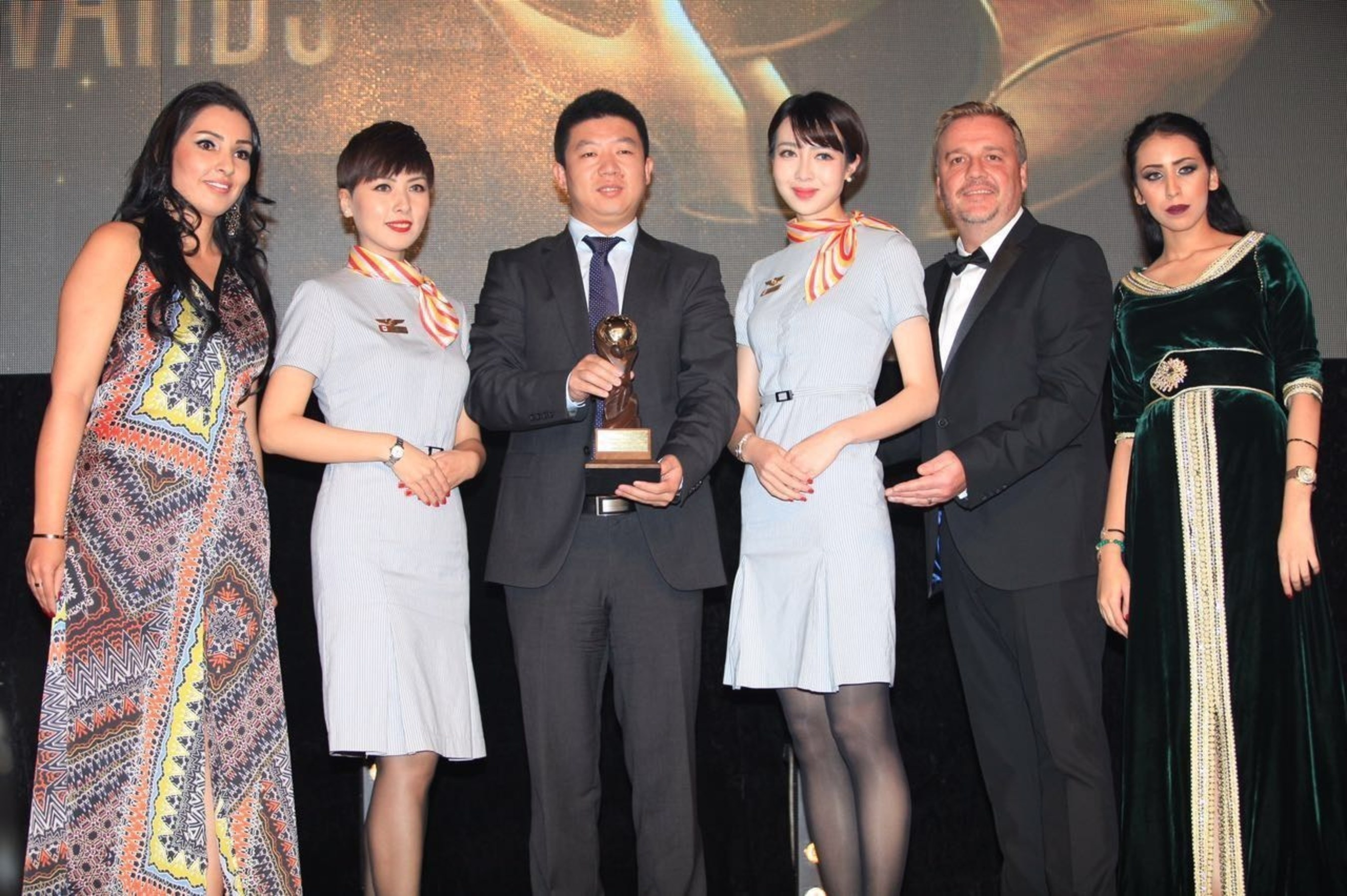 Chris Frost, vice president of World Travel Awards (2nd from right), congratulating Hainan Airlines while ...