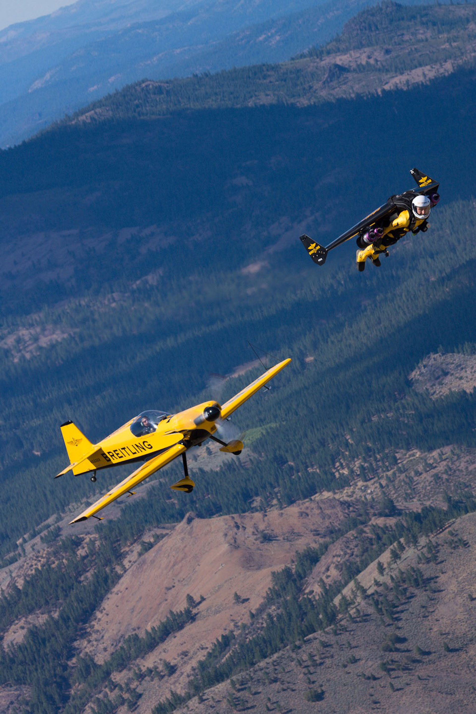 """Yves """"Jetman"""" Rossy flies over Reno with a CAP 232 plane during a test flight prior to his appearance at the National Championship Air Races. Photo Credit: Bernet, courtesy of Breitling SA. (PRNewsFoto/Breitling, Bernet) (PRNewsFoto/BREITLING)"""