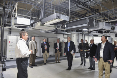 LG Applications Engineer Ed Ferrier provides media with a tour of the state-of-the-art Engineering Control Lab at the grand opening of the LG Electronics USA Air Conditioning Systems headquarters on Wednesday, November 11, 2015 in Alpharetta, GA. (Photo by John Amis/AP Images for LG Electronics USA)