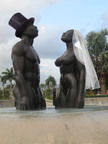 "It's Valentine's Day and in Jamaica, everyone gets in on the act. Though they aren't able to verbally say ""I do!"" this 'statuesque' couple in Kingston's Emancipation Park has (un)dressed for the part.  Adorned with a veil and top hat in honor of the February 14 group nude wedding at Hedonism II in Negril, the Redemption Song statue represents unbridled freedom.  The work by Laura Facey-Cooper bears the inscription, ""None but ourselves can free our minds.""  The ten couples baring all while exchanging vows at Hedonism couldn't agree more. For more information, visit http://www.hedonism.com/nudeweddingphotos/.  (PRNewsFoto/SuperClubs)"