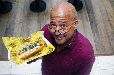 Aramark, the award-winning food and beverage partner at eight MLB stadiums, today announced an expanded partnership with Andrew Zimmern. The three-time James Beard Award-winning TV personality, chef and teacher developed four signature items exclusively for Aramark's menus this baseball season, including AZ's Canteen Dog, pictured here, held by Zimmern.