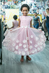 Leah Still, daughter of Houston Texans player Devon Still, models one of her custom dresses for The Knot Dream Wedding, designed by Hayley Paige