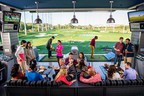 Guests playing Topgolf in Naperville, IL