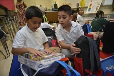 Hidden Valley Elementary children were surprised with school supplies during class.